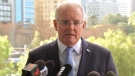 In this image made from video, Australian Prime Minister Scott Morrison holds a press conference Monday, June 24, 2019, in Perth, Australia. (Australian Broadcasting Corporation via AP)