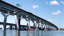 The new Samuel de Champlain bridge is seen with the old bridge in the background in Montreal on Monday, June 17, 2019. THE CANADIAN PRESS/Paul Chiasson