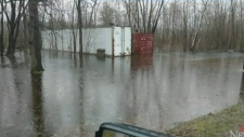 Community comes to rescue after camp storage flood