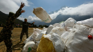 Nepalese army men pile up the garbage collected from Mount Everest in Namche Bajar, Solukhumbu district, Nepal, May 27, 2019. (AP / Niranjan Shrestha)