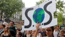 Youth holds a placard as she takes part to a climate march in Paris, Friday, May 24, 2019. (AP Photo/Michel Euler)