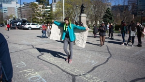 A 15-year-old Toronto student has received a $1,444.51 bill for the clean-up of sidewalk chalk graffiti after a student protest against education cuts at the Ontario legislature. (Aidan Samuels)
