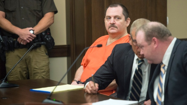 FILE - In this June 19, 2018 file photo, Aubrey Trail, left, looks on during a hearing in Saline County Court, in Wilbur, Neb. Trail, on trial for the 2017 slaying of a Lincoln woman has slashed his neck and fallen from a wheelchair during court proceedings Monday, June 24, 2019. (Eric Gregory/Lincoln Journal Star via AP File)