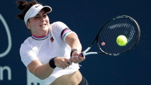 Bianca Andreescu, of Canada, returns to Anett Kontaveit, of Estonia, during the Miami Open tennis tournament, Monday, March 25, 2019, in Miami Gardens, Fla. (THE CANADIAN PRESS/AP, Lynne Sladky)