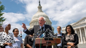 U.S. Democratic presidential candidate, Sen. Bernie Sanders, I-Vt., flanked by Rep. Ilhan Omar, D-Minn., left, and Rep. Pramila Jayapal, D-Wash., right, calls for legislation to cancel all student debt, at the Capitol in Washington, Monday, June 24, 2019.  (AP Photo/J. Scott Applewhite)