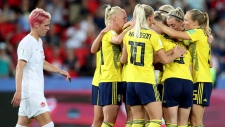 Team Sweden celebrates after scoring the opening goal during the Women's World Cup round of 16 soccer match between Canada and Sweden at Parc des Princes in Paris, France, Monday, June 24, 2019. (AP Photo/Francisco Seco)