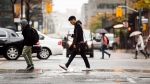People cross the road in downtown Toronto on Friday, Nov. 2, 2018. (THE CANADIAN PRESS/Nathan Denette)