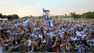 A crowd waves Quebec flags before the Fete nationale show on the Plains of Abraham in Quebec City, Saturday June 23, 2012. THE CANADIAN PRESS/Francis Vachon.
