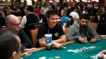 """Jeopardy!"" champion and professional sports gambler James Holzhauer, centre, plays in a tournament at the World Series of Poker, Monday, June 24, 2019, in Las Vegas. (AP Photo/John Locher)"