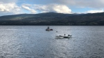 Two people are in hospital after a small plane crashed into Okanagan Lake.