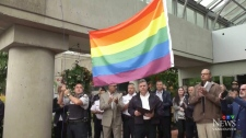 Protesters clash as Mounties raise Pride flag
