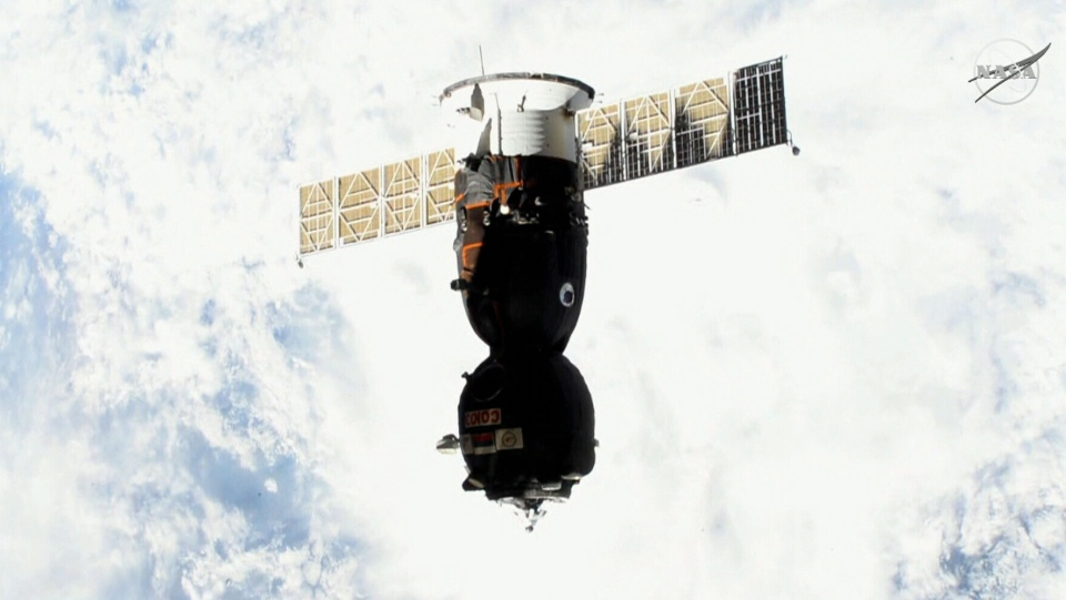 A Soyuz space capsule containing three astronauts, including Canadian David Saint-Jacques, makes its return to Earth.