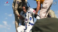 Canadian astronaut David Saint-Jacques is helped out of a Soyuz space capsule after returning to Earth. (NASA TV)