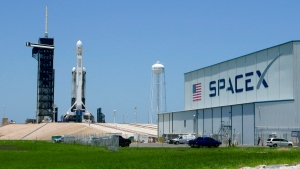 A SpaceX Falcon heavy rocket stands ready for launch on pad 39A at the Kennedy Space Center in Cape Canaveral, Fla., Monday, June 24, 2019. (AP Photo/John Raoux)