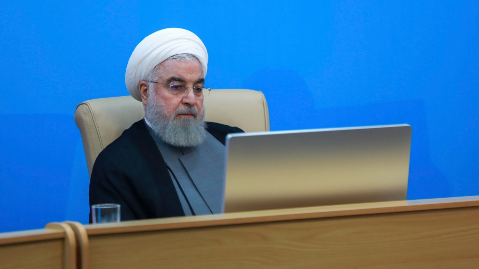Iranian President Hassan Rouhani attends a meeting with the Health Ministry officials in Tehran, Iran, Tuesday, June 25, 2019. (Iranian Presidency Office via AP)