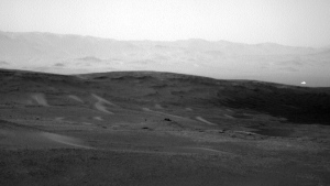 NASA has released this image taken by the Curiosity rover on June 16, which shows a bright spot on a distant hill on the surface of Mars. (NASA/JPL-Caltech)