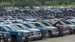 Vehicles are seen in a parking lot at the General Motors Oshawa Assembly Plant in Oshawa, Ont., on June 20, 2018. (Tijana Martin / THE CANADIAN PRESS)