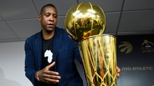 Toronto Raptors president Masai Ujiri leaves with the Larry O'Brien Championship Trophy after speaking to the media during a year end press conference in Toronto on Tuesday, June 25, 2019. THE CANADIAN PRESS/Nathan Denette