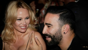 Pamela Anderson and France World Cup-winning player Adil Rami at the Crazy Horse cabaret in Paris on June 3. (AFP)