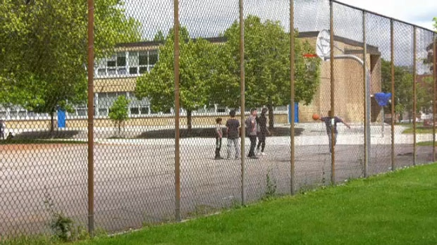 Kids play at a basketball court near Dundas Street and Broadview Avenue on June 25, 2019.