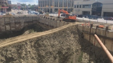 Crews begin work backfilling the Capital Pointe hole (Cole Davenport / CTV Regina)