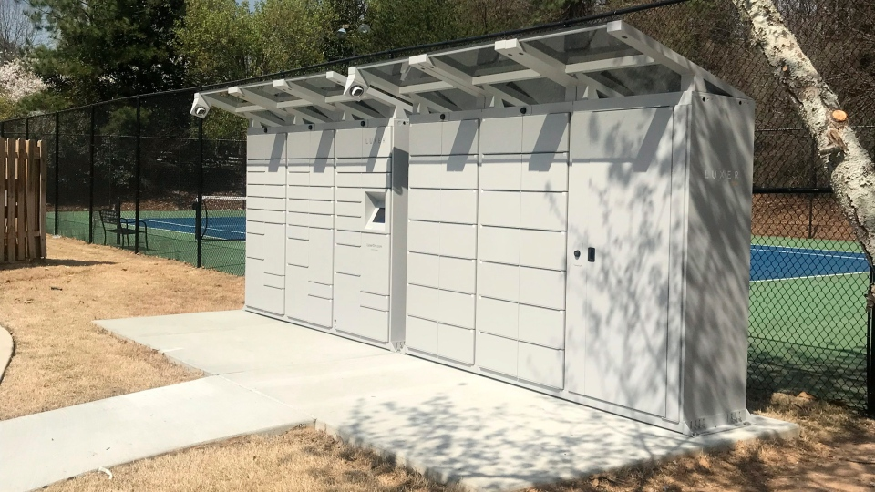 This photo provided by Luxer One shows one of their outdoor access lockers for packages. Luxer One provides secure lockers in buildings in the United States and Canada that can be accessed by both delivery companies and residents. (Luxer One via AP)