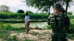 Mexican authorities walk along the Rio Grande bank where the bodies of Salvadoran migrant Oscar Alberto Martínez Ramírez and his nearly 2-year-old daughter Valeria were found, in Matamoros, Mexico, Monday, June 24, 2019. (AP Photo/Julia Le Duc)