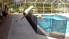 Dad makes big jump to save son from pool