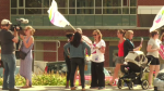 Nurses and protestors rally outside Grand River Hospital over recent cuts to positions.