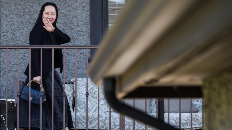 Huawei chief financial officer Meng Wanzhou, waves as she returns home after attending a court appearance in Vancouver, on May 8, 2019. (Darryl Dyck / THE CANADIAN PRESS)