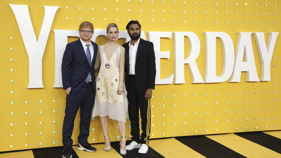 Singer Ed Sheeran, from left, actors Lily James and Himesh Patel at the premiere of 'Yesterday' in London, on June 18, 2019. (Photo by Vianney Le Caer / Invision / AP)