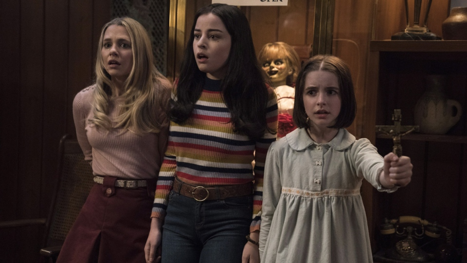 Madison Iseman, Katie Sarife and McKenna Grace in 'Annabelle Comes Home.' (Dan McFadden / Warner Bros. Pictures via AP)
