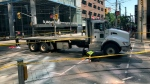Officers are seen investigating a fatal crash in downtown Toronto on June 26, 2019. (CTV News Toronto / Corey Baird)