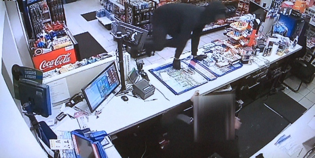 A violent robbery at a gas station near Front and Shebourne streets was caught on camera. (Toronto Police Service)