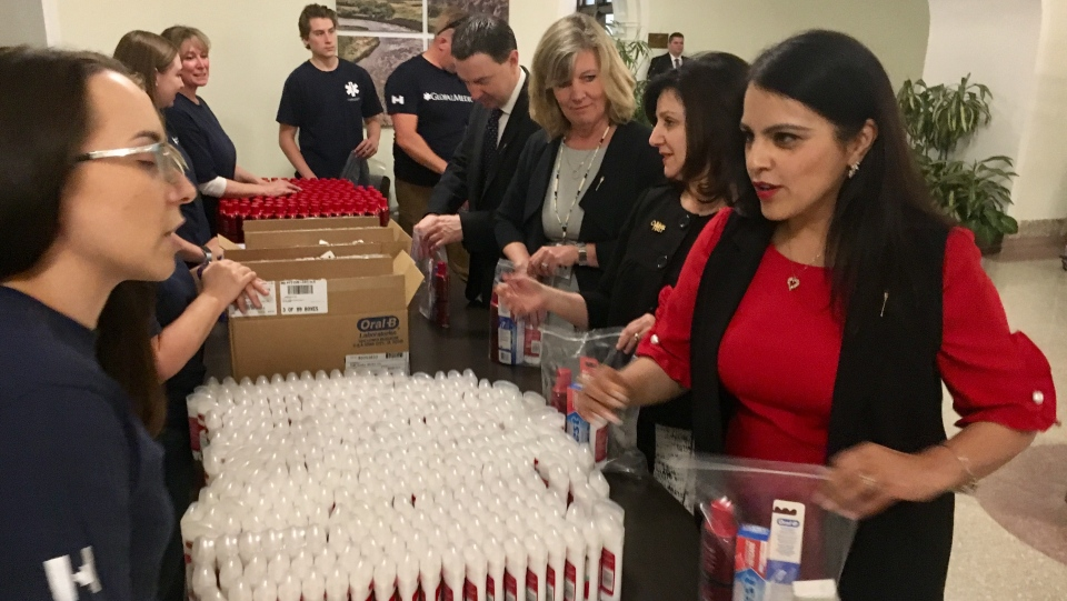 Alberta MLAs assemble relief kits for people affected by the wildfires.