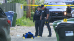 Police put down evidence markers in an alley in Southview after a woman was shot by police on Wednesday, June 26, 2019.