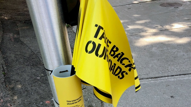 Pedestrians flags are seen at the intersection of Bathurst and Nine streets on June 26, 2019. (CTV News Toronto / Natalie Johnson)