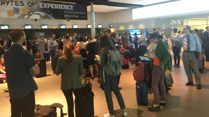 Delayed passengers wait at a check-in counter at Bill Bishop Airport in downtown Toronto Wednesday June 26, 2019. (Miranda Anthistle /CTV News Toronto)