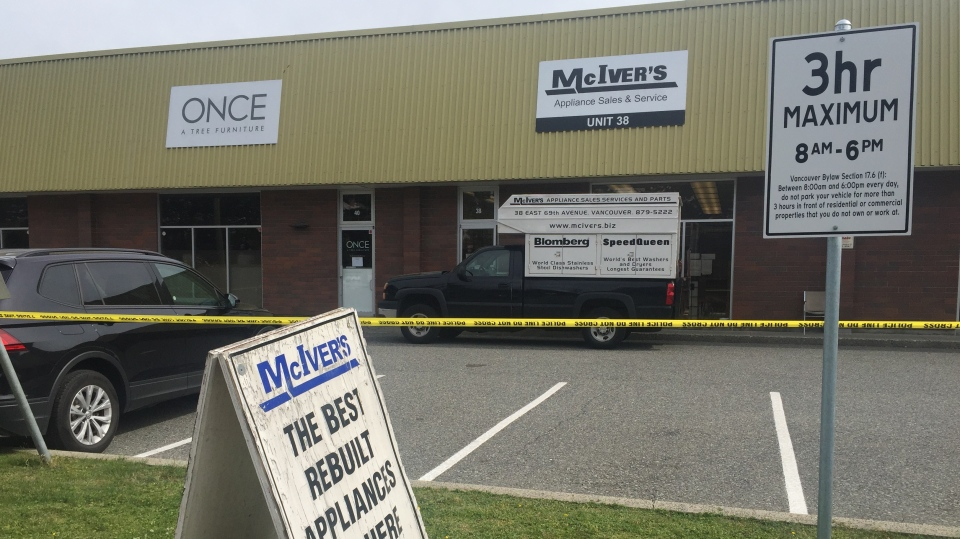 Police are at the scene of a suspicious death at an appliance store in South Vancouver. (Christian Adler / CTV News Vancouver)