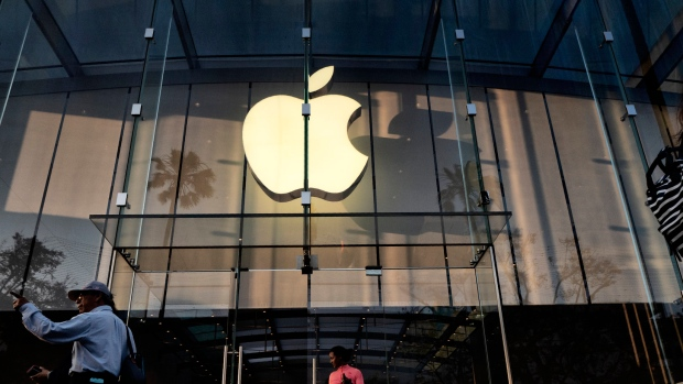 In this Saturday June 15, 2019 photo customers leave an Apple store on the 3rd Street Promenade in Santa Monica, Calif. (AP Photo/Richard Vogel)