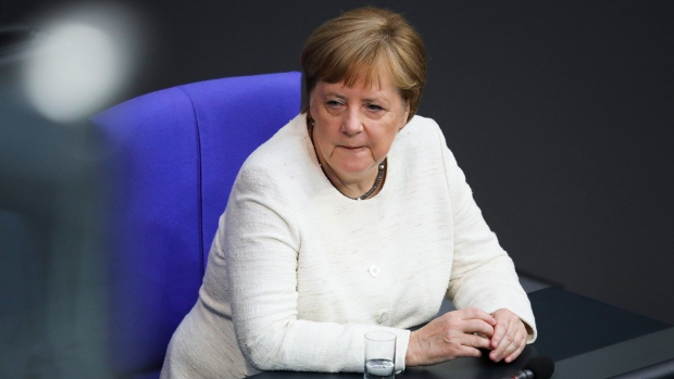 Germany's Merkel shaking again at event in Berlin