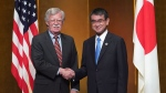 U.S. National Security Adviser John Bolton, left, and Japanese Foreign Minister Taro Kono pose for a photo prior to their meeting ahead of the G-20 summit in Osaka, western Japan, Thursday, June 27, 2019. (AP Photo/Eugene Hoshiko, Pool)