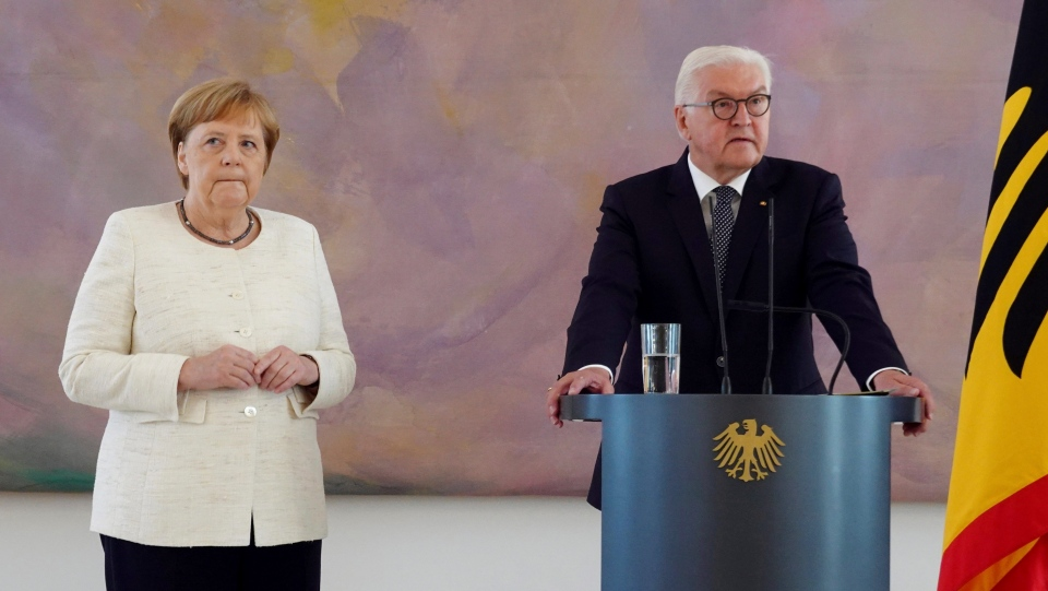 German Chancellor Angela Merkel (CDU, l) takes part in the presentation of the appointment and dismissal certificate as Federal Minister of Justice to Katarina Barley (SPD) and the new Federal Minister of Justice Christine Lambrecht (SPD) by Federal President Frank-Walter Steinmeier, right, in Bellevue Castle in Berlin, Thurday, June 27, 2019. (Kay Nietfeld/dpa via AP)