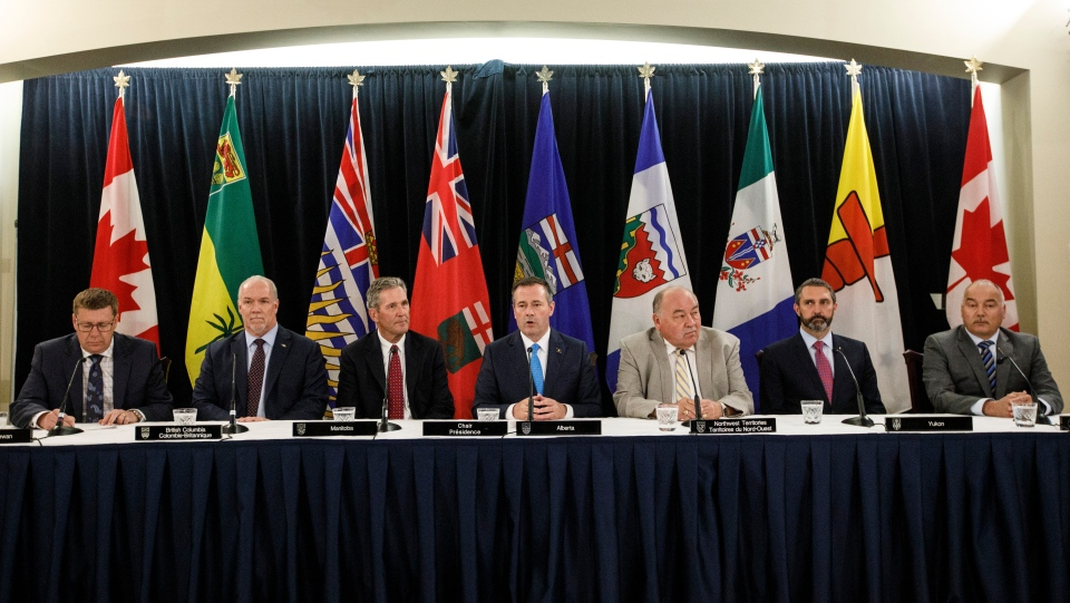 Saskatchewan Premier Scott Moe, left to right, British Columbia Premier John Horgan, Premier of Manitoba Brian Pallister, Alberta Premier Jason Kenney, Premier of Northwest Territories Robert McLeod, Premier of Yukon Sandy Silver and Premier of Nunavut Joe Savikataaq take part in a press conference at the Western Premiers' conference, in Edmonton on Thursday, June 27, 2019. THE CANADIAN PRESS/Jason Franson