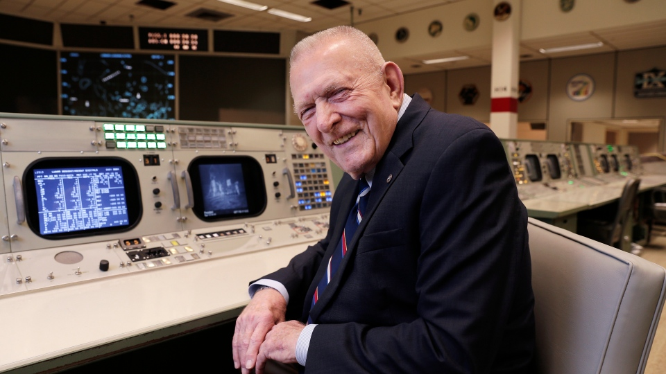 Gene Kranz, aerospace engineer, fighter pilot, an Apollo-era flight director and later director of NASA flight operations, sits at the console where he worked during the Gemini and Apollo missions at the NASA Johnson Space Center Monday, June 17, 2019, in Houston. (AP Photo/Michael Wyke)