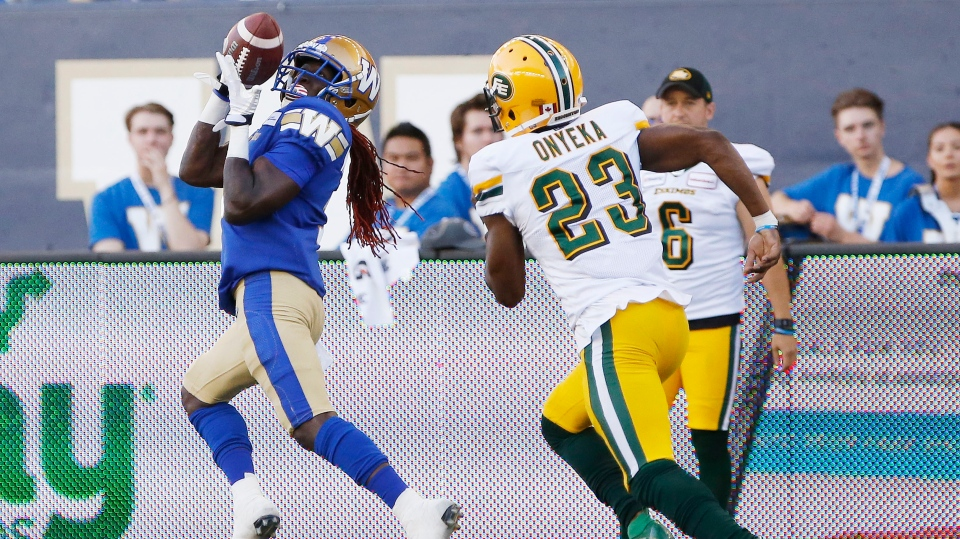 Edmonton Eskimos' Godfrey Onyeka can't stop Winnipeg Blue Bombers' Lucky Whitehead as he hauls in the pass and runs it in for the touchdown during the first half of CFL action in Winnipeg Thursday, June 27, 2019. (John Woods / THE CANADIAN PRESS)
