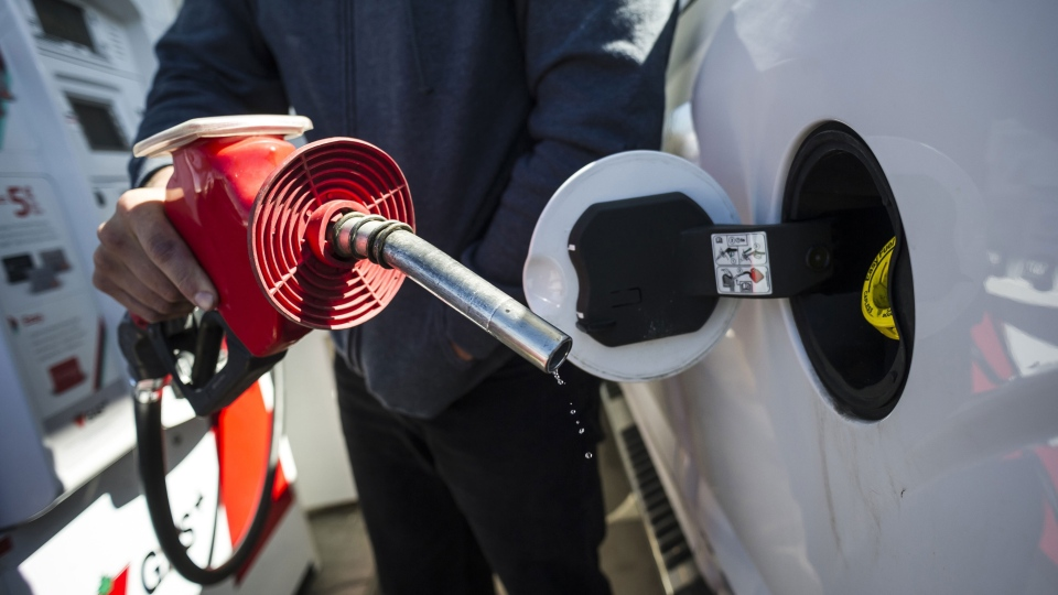 A man fills up his truck with gas in Toronto, on Monday April 1, 2019. THE CANADIAN PRESS/Christopher Katsarov