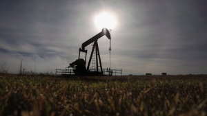 A pumpjack works at a well head on an oil and gas installation near Cremona, Alta., Saturday, Oct. 29, 2016. THE CANADIAN PRESS/Jeff McIntosh