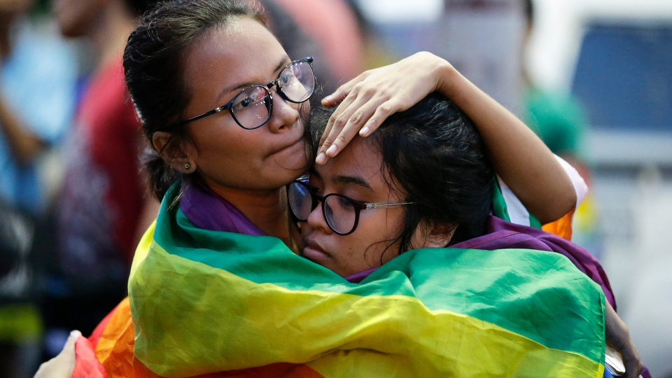LGBTQ community members at Pride march