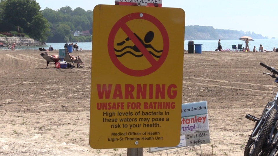 A sign warns of high E. coli levels at a beach in Port Stanley, Ont. on Friday, June 28, 2019. (Celine Moreau / CTV London)